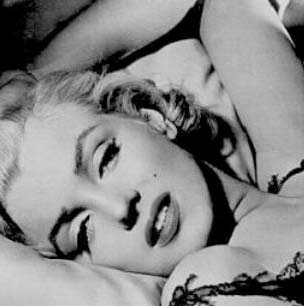 An inimmitable Marilyn Monroe bedroom gaze.